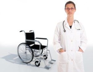 Image of doctor and wheelchair - should you sign hospital discharge forms