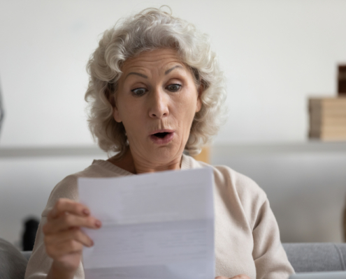 Surprised lady looking at letter
