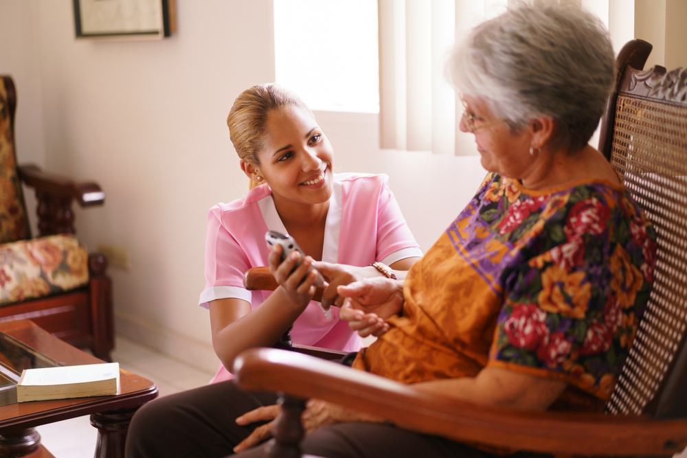 A nurse helps the senior woman
